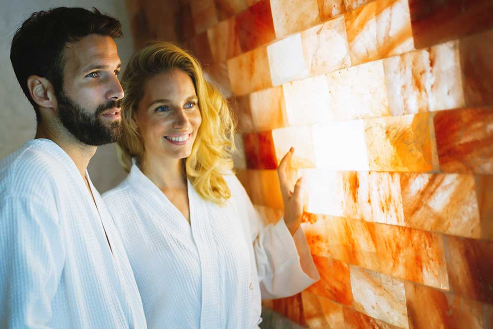 couple enjoying a salt room treatment